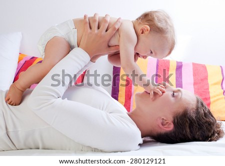 Mother playing with her baby girl - stock photo