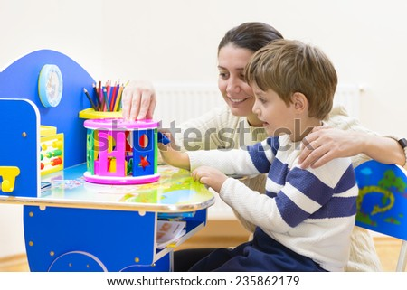 Mother playing with her child some creativity game - stock photo