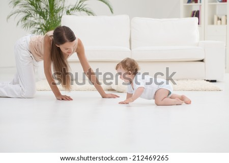 Mother playing with her cute baby boy. - stock photo