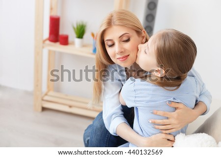 Mother playing with her daughter at home