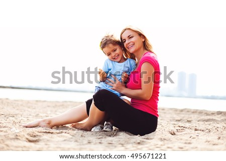 Mother playing with her daughter outside