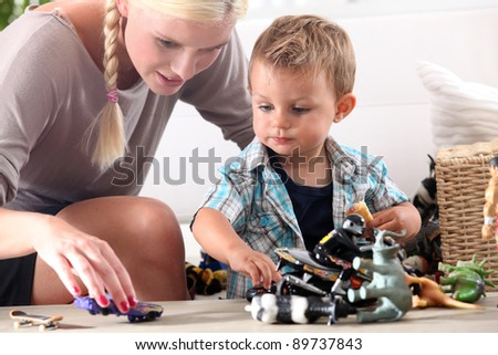 Mother playing with her little boy - stock photo