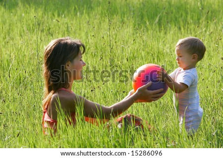 mother playing with her son - stock photo