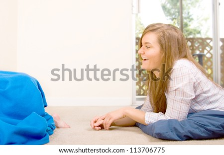 mother playing with son hide and seek - stock photo