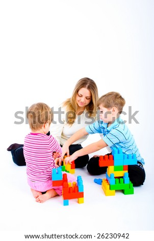 mother playing with two children on white
