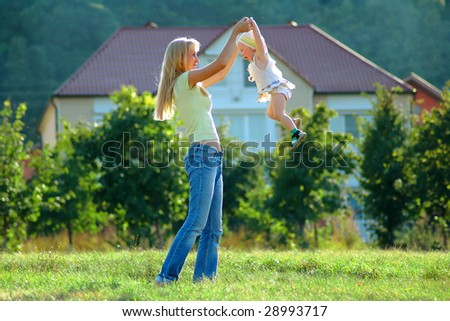Mother plays with small girl - stock photo