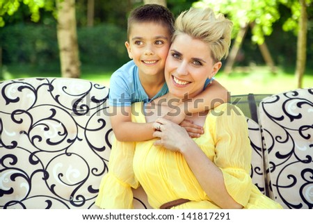 Mother posing with her son - stock photo