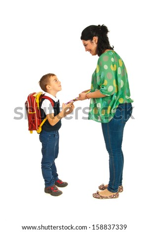 Mother prepare boy for school and giving him notebooks - stock photo