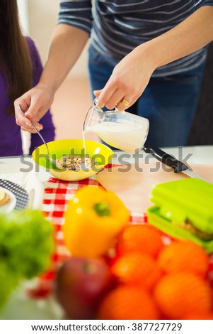 Mother preparing healthy meals for child