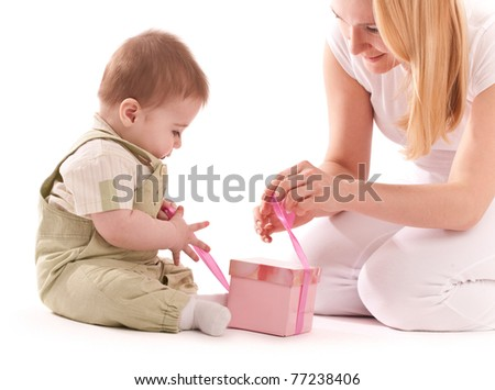 Mother present to her baby boy gift in pink box - stock photo