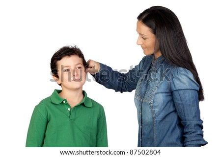Mother pulling her child's ear for being naughty isolated on white background - stock photo