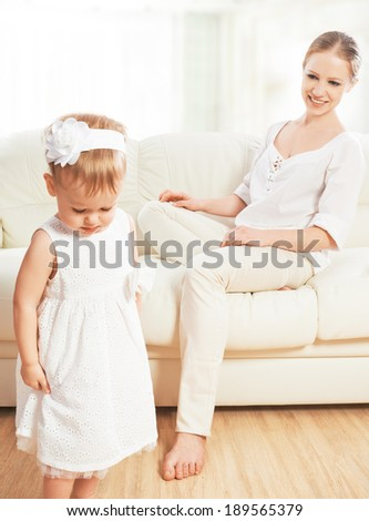 mother punishes abuses baby child daughter - stock photo