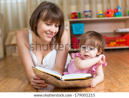 mother reading a book to child at home