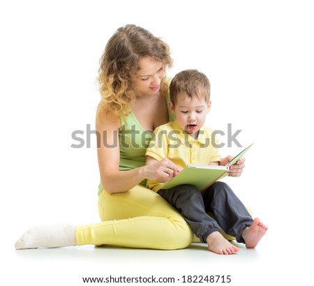 mother reading a book to her child boy - stock photo