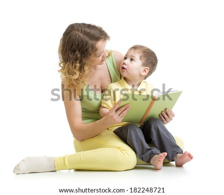 mother reading a book to her kid boy - stock photo