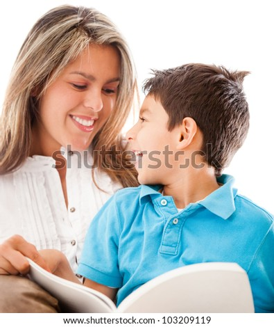 Mother reading a book to her son - isolated over a white background - stock photo