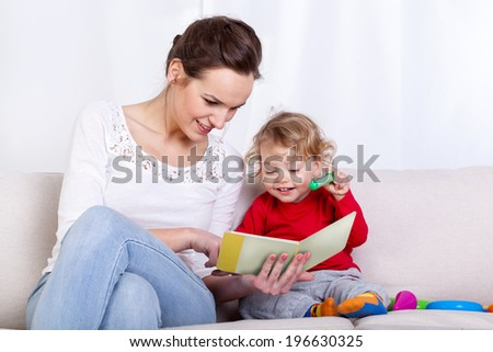 Mother reading book with her child, horizontal
