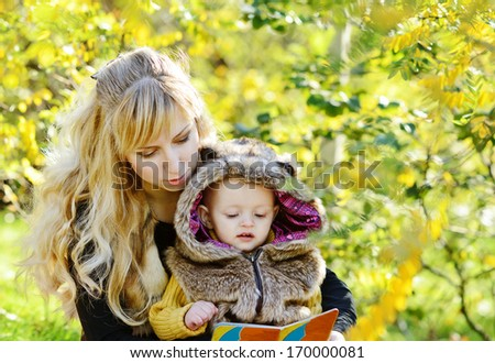 mother reading for baby son - stock photo