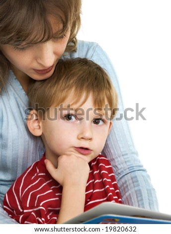 Mother reads to son the book - stock photo