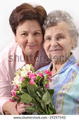 mother receives a bunch of flower from her daughter - stock photo