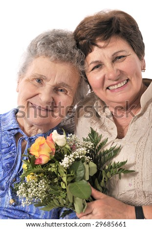 mother receives a bunch of flower from her daughter