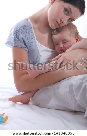 Mother rocking her baby - stock photo