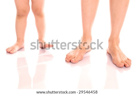 Mother's and son's feet isolated on white