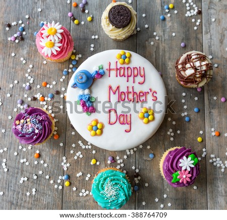 Mother's Day cake with a circle of cupcakes seen from above - stock photo