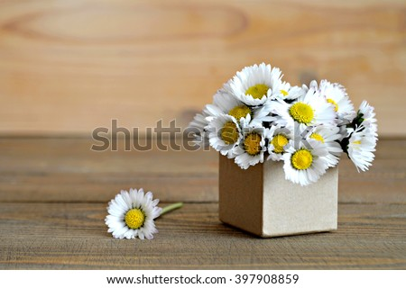 Mother's Day card: Daisy flowers arranged in gift box - stock photo