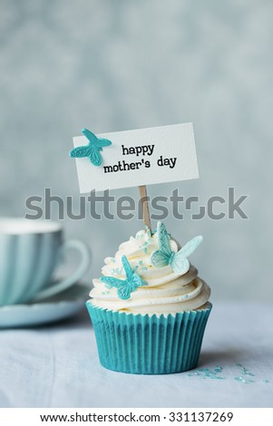 Mother's day cupcake with butterflies - stock photo