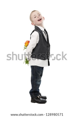 mother's day, little boy hiding flowers behind his back. Isolated on white background - stock photo