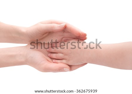 Mother's hands hold child's hand.