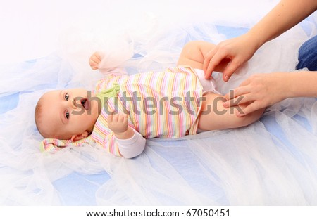 Mother's hands holding her baby. Mothercraft concept. - stock photo