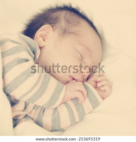 Mother's happiness little sleeping newborn baby - stock photo
