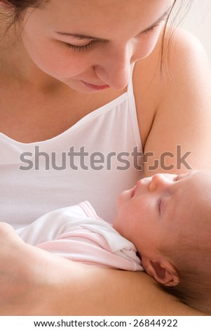 Mother's love. Cute baby 1,5 month with mother.