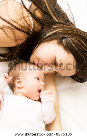Mother's love. Cute baby 1,5 month with mother. - stock photo