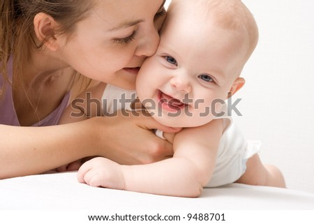 Mother's love. Cute baby 5 month with mother. [5 months] - stock photo