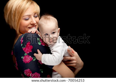 mother's love -  cute 5 month baby boy with mother - stock photo