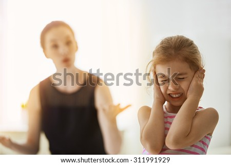 mother scolds her child - stock photo