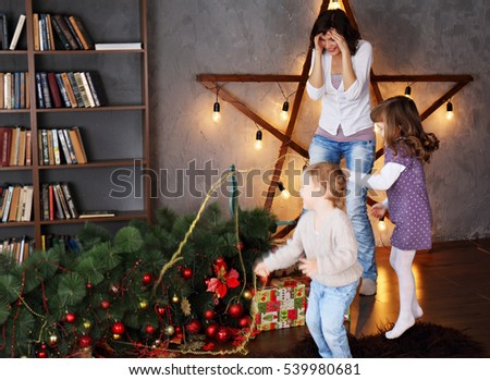 Mother shocked that children piled the Christmas tree. Christmas concept
