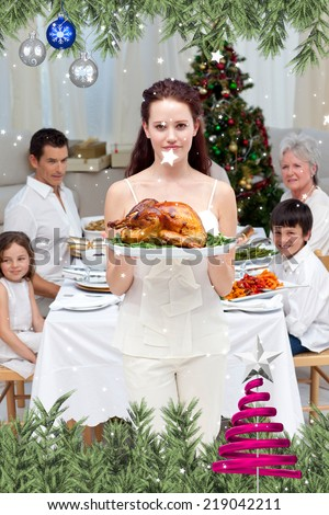 Mother showing turkey for Christmas dinner against twinkling stars - stock photo