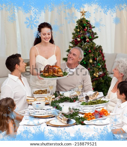 Mother showing turkey to her family for Christmas against snow flake frame in blue - stock photo