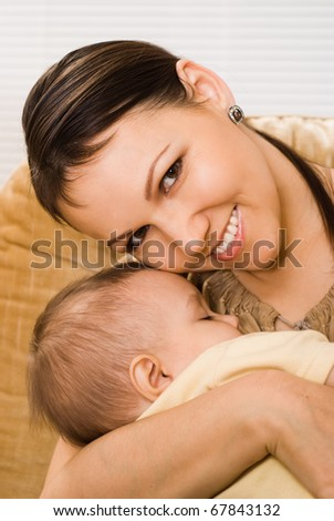 mother sitting with her slipping  baby