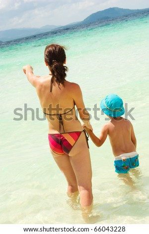 Mother something to her son during their vacation - stock photo