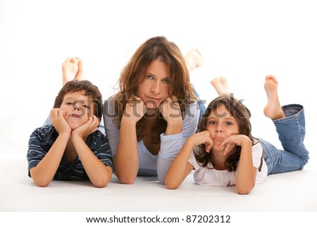 Mother, son and daughter with a sad expression on a white background. - stock photo