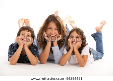 Mother, son and daughter with hands on face having fun on a white background. - stock photo