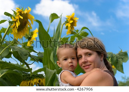 Mother, son and sunflower - stock photo