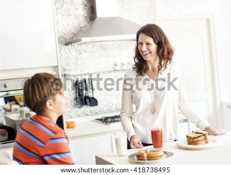 Mother Son Care Communication Kitchen Concept - stock photo