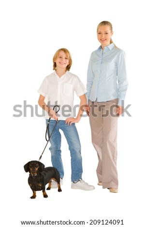 mother son standing and smiling with small dog isolated on white background - stock photo