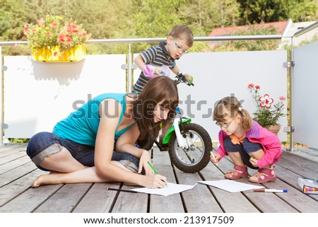 Mother spends time with her children - stock photo